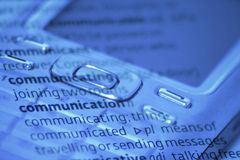 Communication. Close up of mobile phone in blue Royalty Free Stock Photo