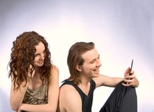 Communication. Young Couple talking on cell phones Stock Photo