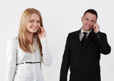 Communication. Young couple using mobile phones.Selective focus on the blonde woman Stock Photos