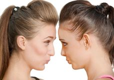 Communication. Close-up portrait of funny two girlfriend looking at each other Royalty Free Stock Photo