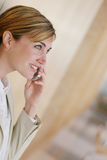 Communication. Young woman talks on cellphone Royalty Free Stock Photography
