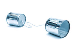 Communication. Old toy phone - two cans and rope Stock Image