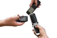 Communication. Three mobile phones in hands Stock Photography