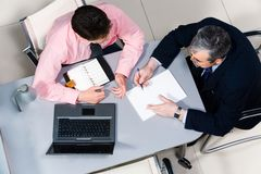 Communication. View from above of two businessmen speaking in the office during meeting Stock Image