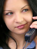 Communication. Woman talking on the phone, smiling, portrait, close up stock photography