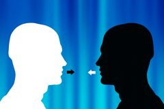 Communication. Two opposite male heads silhouette facing each other - communication concept Royalty Free Stock Images