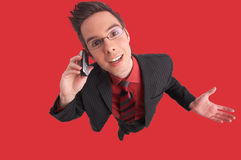 Communication. Businessman talks on the phone with clipping path included Royalty Free Stock Photo