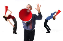 Communication. Business team holding a red megaphone Royalty Free Stock Photography