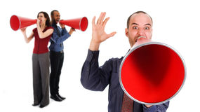 Communication. Business team holding a red megaphone on emotions Royalty Free Stock Images