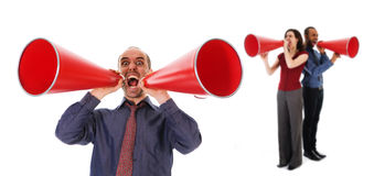 Communication. Business team holding a red megaphone on emotions Royalty Free Stock Photos