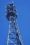 Communication Antenna. Independent communications antenna and a blue background Stock Photos