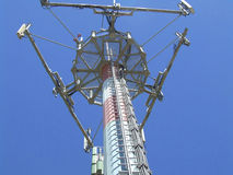 Communication antenna. Repeaters with blue sky stock photo