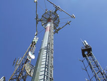Communication antenna. Repeaters with blue sky royalty free stock image