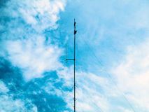 Communication antenna. Communication antenna,With clouds background Royalty Free Stock Photos