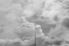 Communication antenna - monochrome. Communication antenna on the sky background - monochrome Royalty Free Stock Images