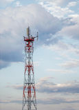 Communication antenna. Telecommunications Tower, against blue sky stock photo