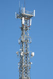 Communication antenna tower and repeater equipment Royalty Free Stock Images
