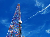 Communication antennas, radio telephone. Mobile phone antennas on blue sky stock photography