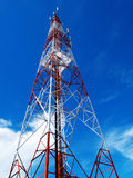 Communication antennas, radio telephone. Mobile phone antennas on blue sky stock image