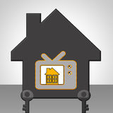 Communication. Black house with television key Royalty Free Stock Photo