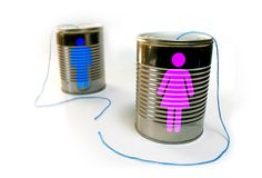Communication Breakdown. Tin can telephone with a broken string. Male and female icons on each can respectively Royalty Free Stock Image