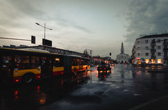 Communication bus in Warsaw. A crossroad in Warsaw with moving vehicles after heavy rain stock images