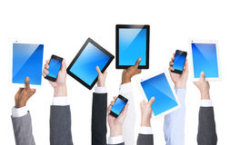 Communication. Business people holding communication devices Royalty Free Stock Image
