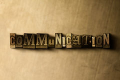 COMMUNICATION - close-up of grungy vintage typeset word on metal backdrop Royalty Free Stock Images