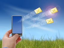 Communication concept. Mobile phone in hand over sky. Communication concept Royalty Free Stock Images