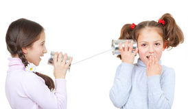 Communication concept. Kids playing with tin can and string phone as communication concept