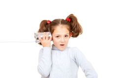 Communication concept. Child listening with tin can and string phone Stock Image
