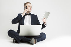 Communication Concept and Ideas. Handsome Caucasian Man in Suit Stock Images