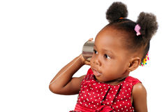 Tin can phone concept 2. Little African American girl listening with tin can phone royalty free stock images