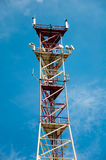 Communication derrick against blue sky Royalty Free Stock Photos