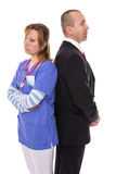 Communication. Doctor stands back to back with her boss Royalty Free Stock Photo