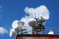 Communication equipment. Mountain peak antennas and communication equipment on blue-sky background Royalty Free Stock Photo