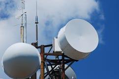 Communication equipment closeup. Mountain peak antennas and communication equipment closeup on blue-sky background Stock Photo