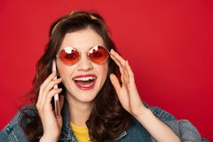 Happy excited hipster girl with mobile phone royalty free stock image