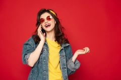 Cheerful young girl talking by mobile phone royalty free stock photo