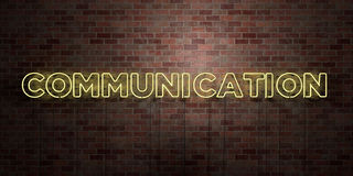 COMMUNICATION - fluorescent Neon tube Sign on brickwork - Front view - 3D rendered royalty free stock picture Royalty Free Stock Image