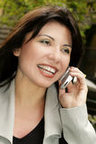 Communication freedom. Happy brunette on the phone Royalty Free Stock Photography