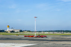 Communication and light mast at apron of Hamburg Airport Stock Photo