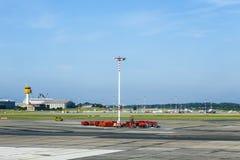 Communication and light mast at apron of Hamburg Airport Stock Photo