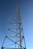 Communication mast. A communication mast against a blue sky Royalty Free Stock Photos