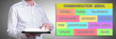 Communication media concept with man using a tablet Stock Images