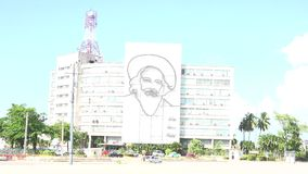 Communication Ministry Building with Camilo Cienfuegos Art in Havana stock footage