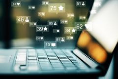 Communication and network concept. Side view and close up of laptop with social media icons. Communication and network concept. Double exposure stock images