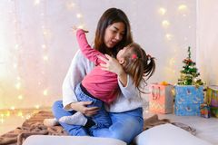 Communication of older female sister with youngest girl sitting royalty free stock photography