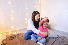 Communication of older female sister with youngest girl who spen stock image