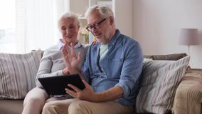 Senior couple having video chat on tablet pc stock footage